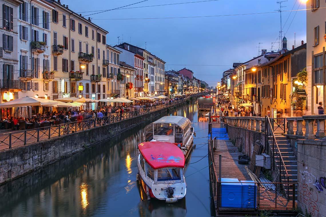 Evening scene along the Naviglio Grande canal in Milan, Italy.