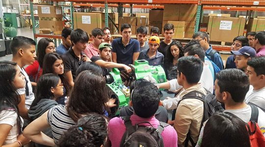 Students in Mexico examining a BITZER compressor