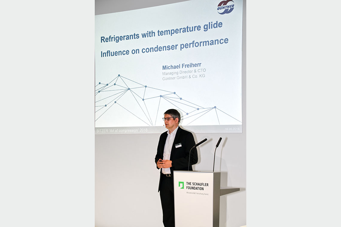"Michael Freiherr, Managing Director & CTO Güntner GmBH & Co. KG, during his speech about ""Refrigerants with Temperature Glide"""