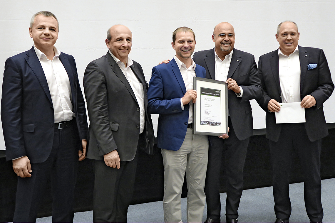 The members of the Management Board of BITZER Gianni Parlanti and Rainer Große-Kracht join Philippe Maratuech and Denis Timokhin to present the Outstanding Green Point Award to Sergei Demidov from Thermocool